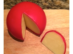 Edam cheese is case in wax to protect it from drying out and from spoilage. I think it is too bland, but my son likes it